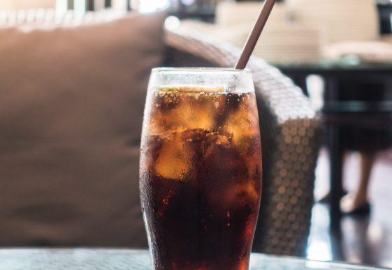 Iced cola glass on table in restaurant - Sunflare effect Processing